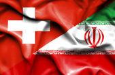Flagge des Iran und der Schweiz winken — Stockfoto