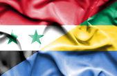 Waving flag of Gabon and Syria — Stock Photo