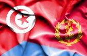Waving flag of Eritrea and Tunisia — Stock Photo