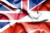 Brandissant le drapeau de l'Autriche et la Grande-Bretagne — Photo