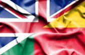 Waving flag of Benin and Great Britain — Stock Photo