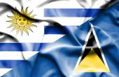 Waving flag of St Lucia and Uruguay — Stock Photo