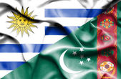 Waving flag of Turkmenistan and Uruguay — Stock Photo