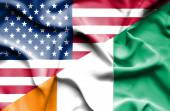 Waving flag of Ivory Coast and USA — Stock Photo