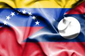Waving flag of Laos and Venezuela — Stockfoto
