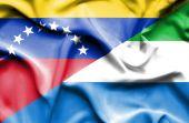 Waving flag of Sierra Leone and Venezuela — Stock Photo