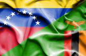 Waving flag of Zimbabwe and Venezuela — Stock Photo