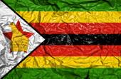 Zimbabwe vintage flag on old crumpled paper background — Stock Photo