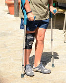 Man walking with crutches, rehabilitation after injury — Stock Photo