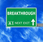BREAKTHROUGH road sign against clear blue sky — Stock Photo