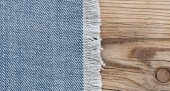 Blue jean texture on wood texture background  — Stock Photo