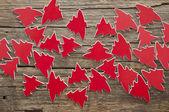 Många röda julgranar som bakgrund eller design element för dig — Stockfoto
