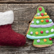 Santa or christmas boot on a wooden background for a greeting ca — Stock Photo #60712507