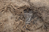 Background of burlap with a hole for writing text. texture of th — Stock Photo