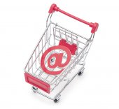 An at sign in a shopping cart, depicting the concept of e-shoppi — Stock Photo