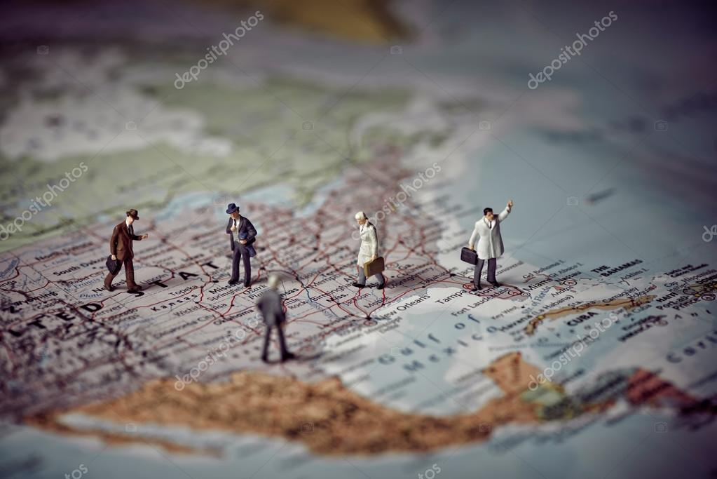 Miniature Business People On Top Of Us Map Business Concept Stock Photo