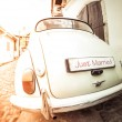 Antique wedding car with just married sign — Stock Photo #53808513