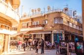 NICOSIA - APRIL 13 : People in restaurants and traditional coffee shops at Ledra street on April 13, 2015 in Nicosia, Cyprus. Ledra, main street of the capital is popular with both tourists and locals — Stock Photo