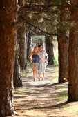 Enamoured guy and the girl walk in wood. — Stock Photo