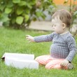 Baby girl looking at book — Stock Photo #54466683