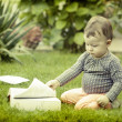 Baby girl looking at book — Stock Photo #54466709