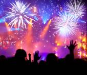 Crowd celebrating the New year with fireworks — Stock Photo