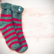 Red and green Christmas socks — Stock Photo #57671195