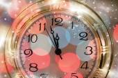 New Year's at midnight - Old clock and holiday lights — Stock Photo