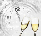 Glasses with champagne and clock — Stock Photo