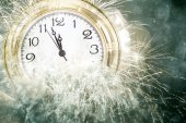 New Year at midnight: Old clock and holiday lights — Stock Photo