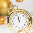 Old golden clock close to midnight and Christmas decorations — Stock Photo #59910083