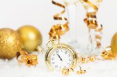 Old golden clock close to midnight and Christmas decorations — Stock Photo
