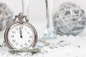 Old silver clock close to midnight and Christmas decorations — Stock Photo