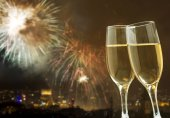 Champagne against fireworks and holiday lights — Stock Photo