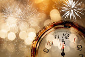 New Year greeting card with vintage clock and holiday lights — Stock Photo