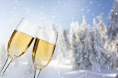 Glasses with champagne on winter background — Photo