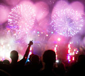 Fireworks and cheering crowd — Stock Photo