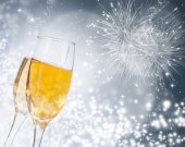 Glasses with champagne against fireworks — Stock Photo
