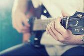 Guitarist playing guitar — Stock Photo