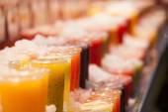 Fresh fruits juices exposed — Stock Photo