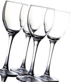 Four empty wine glass isolated over white background — Stock Photo