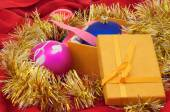Christmas balls with gift box and garland — Stock Photo