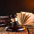 Wooden gavel and books on wooden table — Stock Photo #53305213