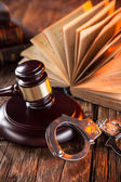 Wooden gavel and books on wooden table — Stock Photo