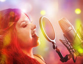 Young singer singing — Stock Photo
