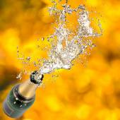 Champagne bottle in explosion — Stock Photo