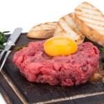 Fresh beef tartar with egg — Stock Photo #54536775