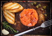 Salmon steak on wooden table — Stock Photo