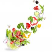Fresh salad with flying vegetables ingredients — Stock Photo