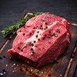 Raw beef steak on wooden table — Stock Photo #55053853
